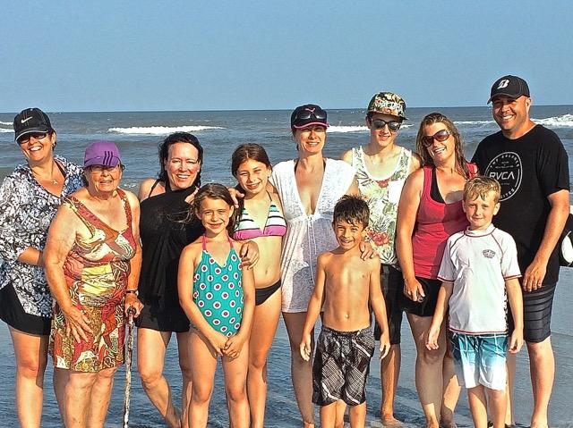 photo de la famille à la mer
