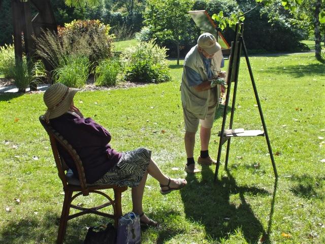 Peintre du dimanche exerçant son art devant son épouse méditative - T-Bear