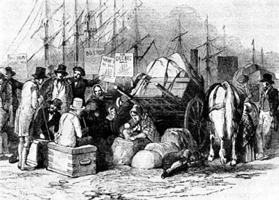 Irish emigrants wait with their few belongings to board ship for North America. Millions were forced to leave by famine (National Archives C-3904).