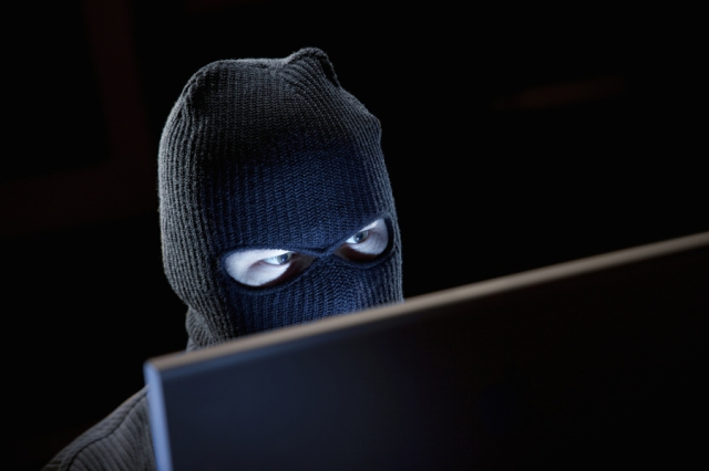 Cyber-terrorist at computer monitor