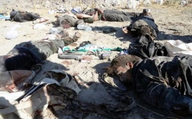 7763319793_plus-de-90-personnes-ici-des-rebelles-dans-la-ville-d-adra-ont-perdu-la-vie-en-syrie-dimanche-dans-des-affrontements-ou-des-bombardements