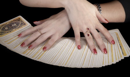 Hands of the fortuneteller on a black background